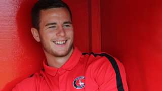 Charlton defender Harry Lennon looks on from the sidelines