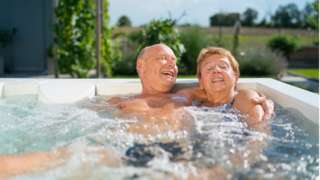 Retiree couple in a hot tub