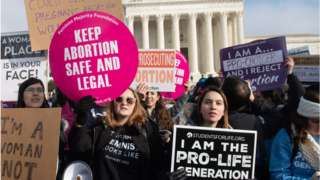 Activists for and against abortion march outside the US Supreme Court on the anniversary of Roe v Wade