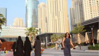 People walking along Dubai Marina (file photo)