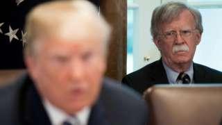 John Bolton (R) looks at Donald Trump (L) (9 May 2018)