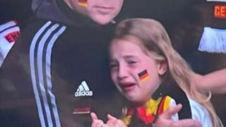 the little girl crying at the match