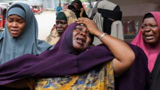 A woman reacts after receiving the confirmation that her son was killed in a suicide bombing attack on a military base, at the Madina Hospital in Mogadishu