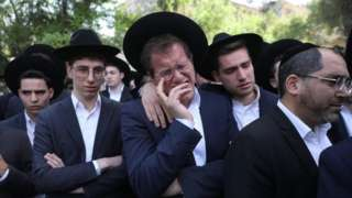 A man weeps at the funeral in Jerusalem of Avrohom Daniel Ambon, one of the 45 people killed in a crush at Lag B'Omer festival in northern Israel (3 May 2021)