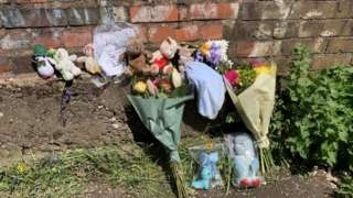 Tributes left on a nearby footbridge