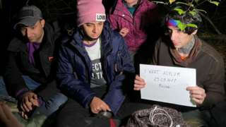 Iraqi migrants hiding in a Polish forest near the Polish town of Chelm shortly after crossing the border from Belarus.