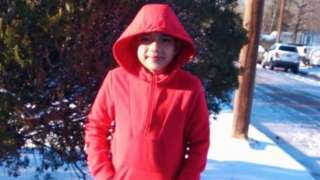 Cristian Pineda wearing a red hoodie in snow