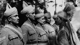 """Types Of Indian Soldiers Being Inspected By Their Officer. This series of pictures were taken of the B.E.F Indian troops """"somewhere in England""""; many of them have just arrived back from Dunkirk under the charge of Major Wainwright and Major Jermyn, two British officers. ("""