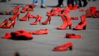 """Pairs of women""""' red shoes, put on display by Mexican visual artist Elina Chauvet to protest against gender violence and femicide, are pictured at Zocalo square in Mexico City, Mexico January 11, 20"""