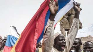 Russians and Malian flags are waved by protesters in Bamako, during a demonstration against French influence in the country on May 27, 2021.