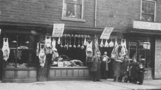 Old photo of meat and people outside shop