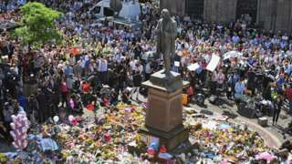 People gather for minute's silence at St Ann's square