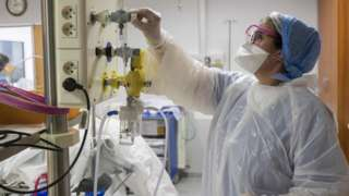Member of medical staff adjusts oxygen supply in French hospital
