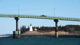 Cars cross the International Bridge between Lubec, Maine (L) and Campobello Island, Canada