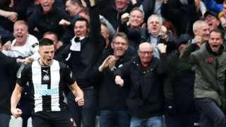 Newcastle celebrate Ciaran Clark's goal