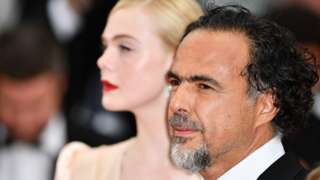 Alejandro Gonzalez Inarritu and Elle Fanning arrive for the screening of the film The Dead Don't Die and the Opening Ceremony at the 72nd annual Cannes Film Festival in Cannes, on May 14, 2019