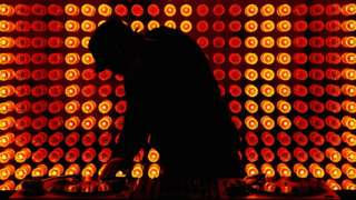 Stock image of a DJ in silhouette