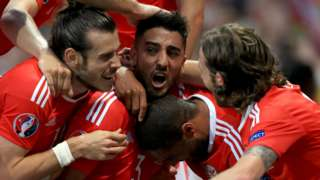 Wales' players celebrate scoring against Russia