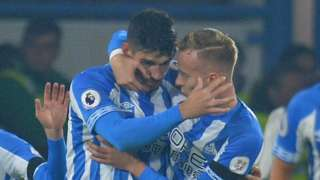 Christopher Schindler (left) celebrates Huddersfield's goal