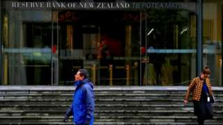 People outside the Reserve Bank of New Zealand in Wellington.