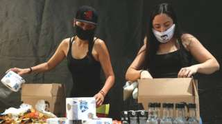 Employees of the clothing brand owned by El Chapo's daughter box up food supplies