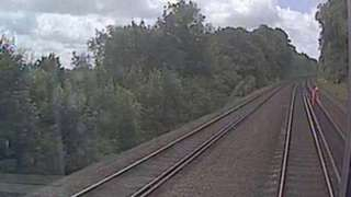 The track worker on the line as pictured by the CCTV camera on the train