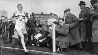 Roger Bannister crosses the finishing line as he runs the first sub-four-minute mile