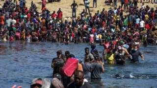 Migrants cross Rio Grande