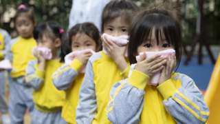 Kindergarten children take part in a fire evacuation drill on the first day of a new semester on February 22, 2021 in Guangzhou, Guangdong Province of China.