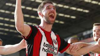 Chris Basham celebrates his goal for Sheffield United
