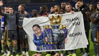 Leicester City players with banner