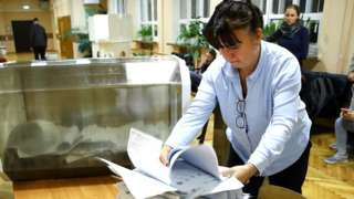 An electoral official during vote count at Polling Station No 144 during the 2021 Russian parliamentary election. Russia held legislative elections on 17-19 September 2021.