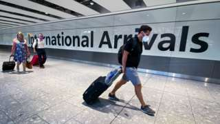 File photo of passengers in the arrivals hall at Heathrow Airport, London.