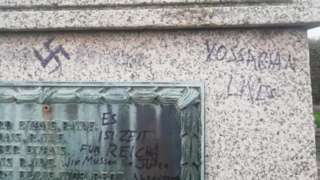A swastika on the war memorial