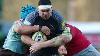 Newcastle Falcons centre Josh Matavesi carries the ball into contact