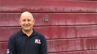 Scott Harrington with garage door