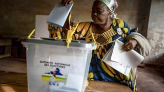 A woman from Central African Republic (CAR) casts her ballot in the presidential and legislative elections at the Lycee Boganda polling station in Bangui, Central African Republic, 27 December 2020.