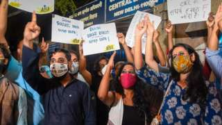 """Student activists Natasha Narwal, Asif Iqbal Tanha and Devangana Kalita outside Tihar prison, after a court ordered their immediate release in the north-east Delhi riots """"conspiracy"""" case, in New Delhi. (Photo: PTI)"""