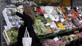 Woman in Denmark shops for fruit and veg