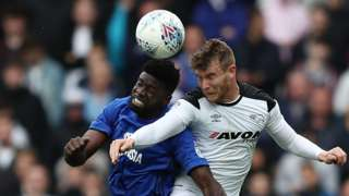 Bruno Ecuele Manga of Cardiff City challenges for the ball with Sam Winnall of Derby County