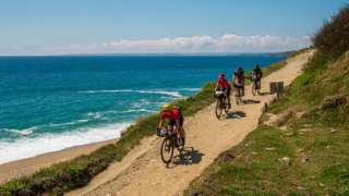 Cyclists riding along the West Cornwall coast