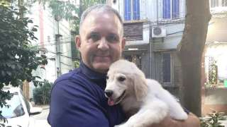 Paul Whelan with a dog