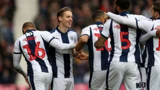 West Brom players celebrate going 1-0 against Ipswich