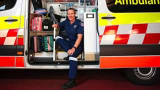 Jo sat in her ambulance