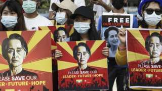 Protesters hold placards calling for the release of detained Myanmar State Counselor Aung San Suu Kyi