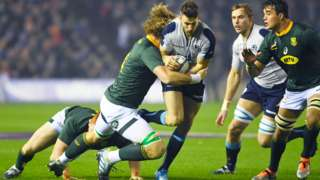 Scotland's Tommy Seymour is tackled by South Africa's RG Snyman