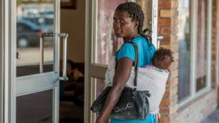 Woman wey carry pikin for back