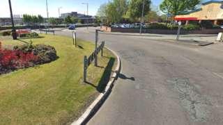 Potholes on roundabout in Wrexham
