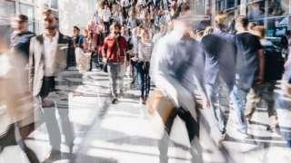 Crowd of people walking in London street