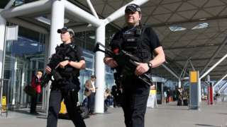 Armed police outside Stansted Airport in March 2016
